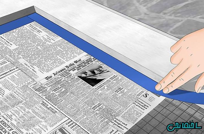 پوشاندن در با روزنامه